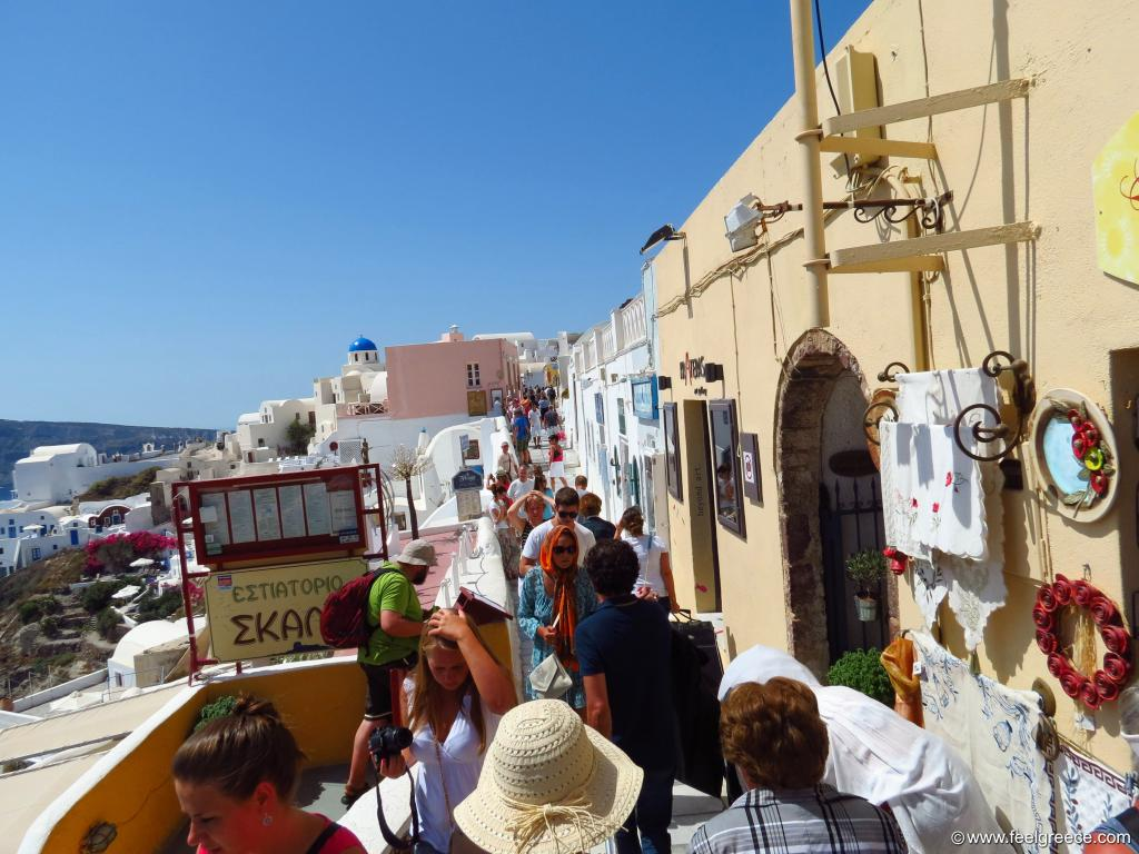 many people fill the narrow Oia streets