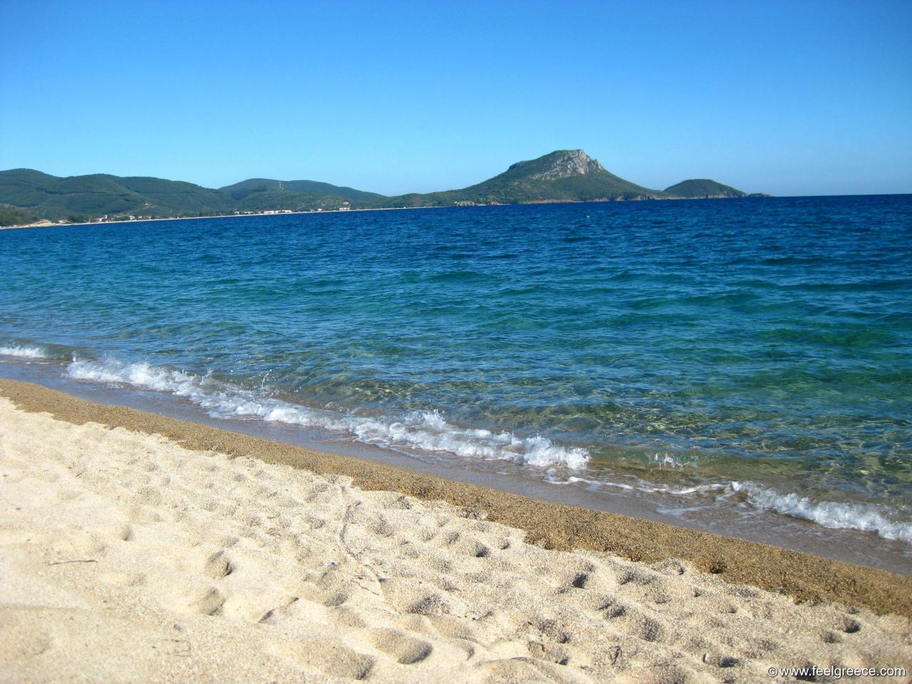 Tristinika beach in Sithonia large beach with coarse sand