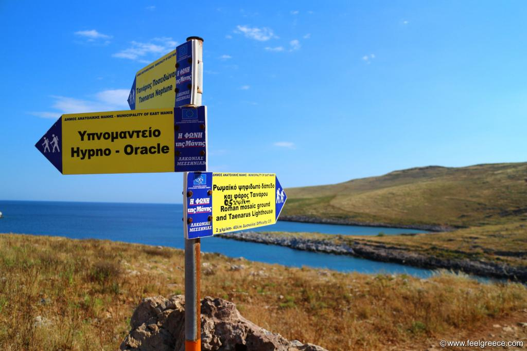 Signboard pointing to the lighthouse and the Roman mosaic