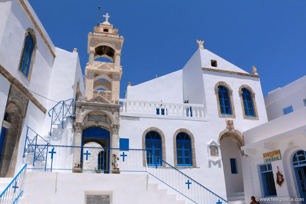 White washed old church with stone bell tower