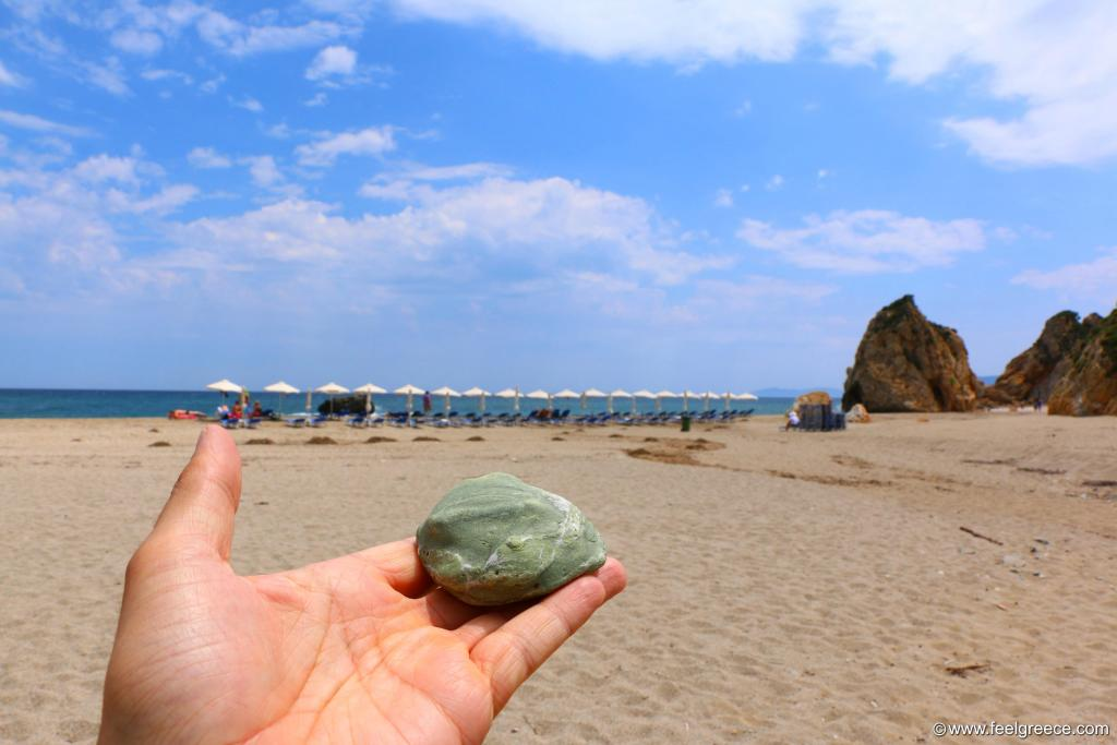 Green stone at the beach
